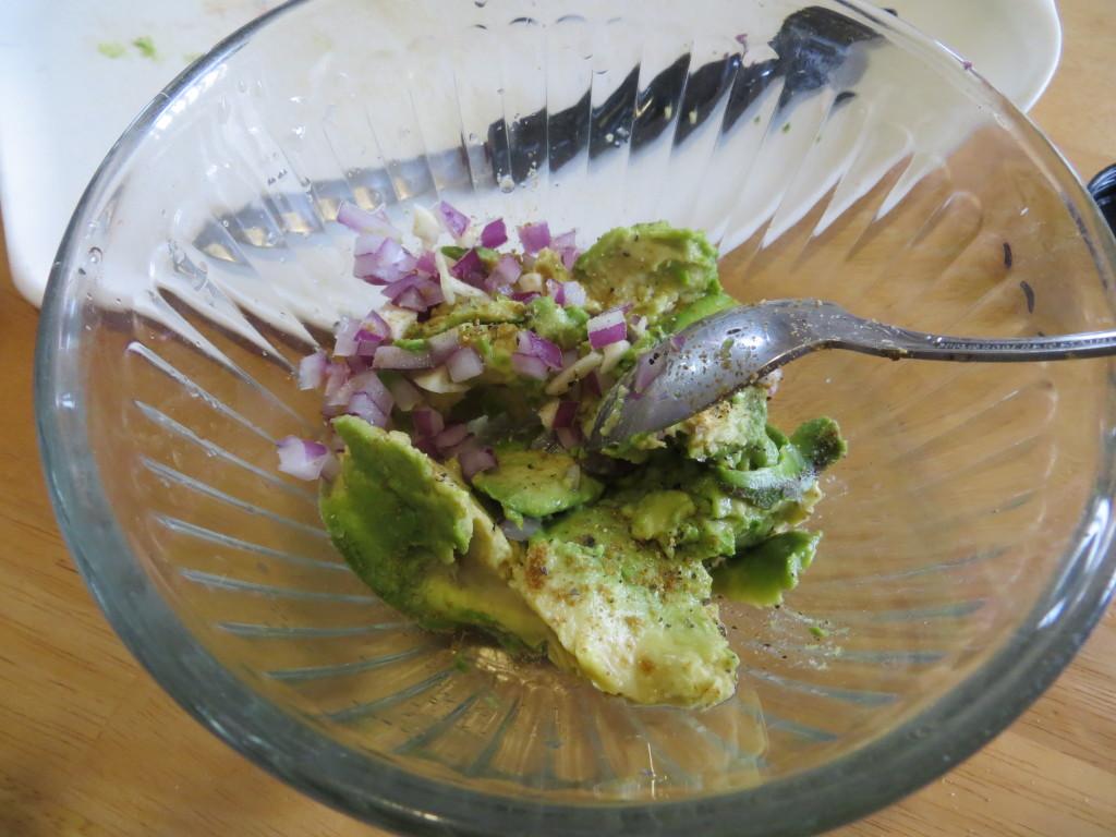 Mixing up fresh Guacamole