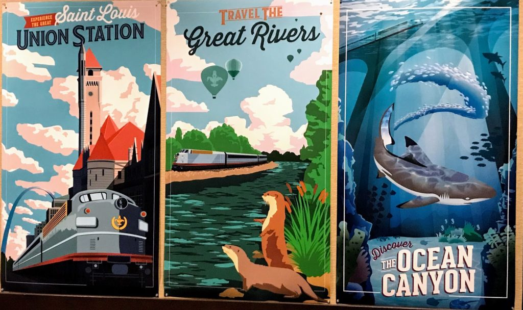 Posters highlighting the St. Louis Aquarium
