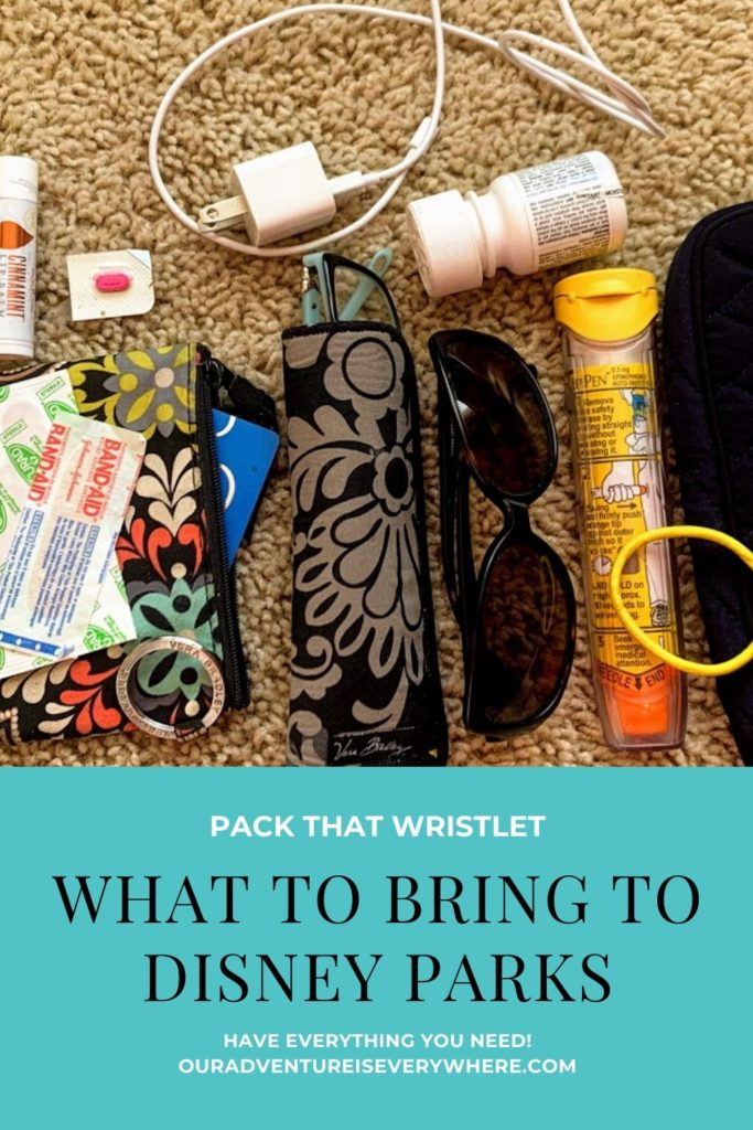 What do you REALLY need in  your bag for a day at the Disney parks? In this post I share the minimum you'll want to pack for a great day at the parks. #ouradventureiseverywhere #disneypacking #disneyvacations