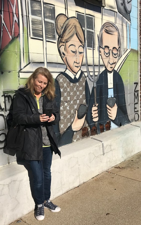 Pose by fun murals to add excitement to your walking tour