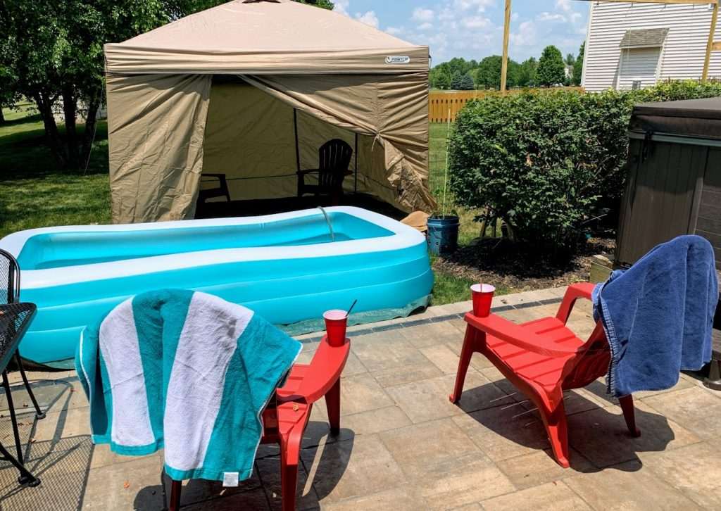Enjoy a faux cabana day in your backyard for on a hot summer day.