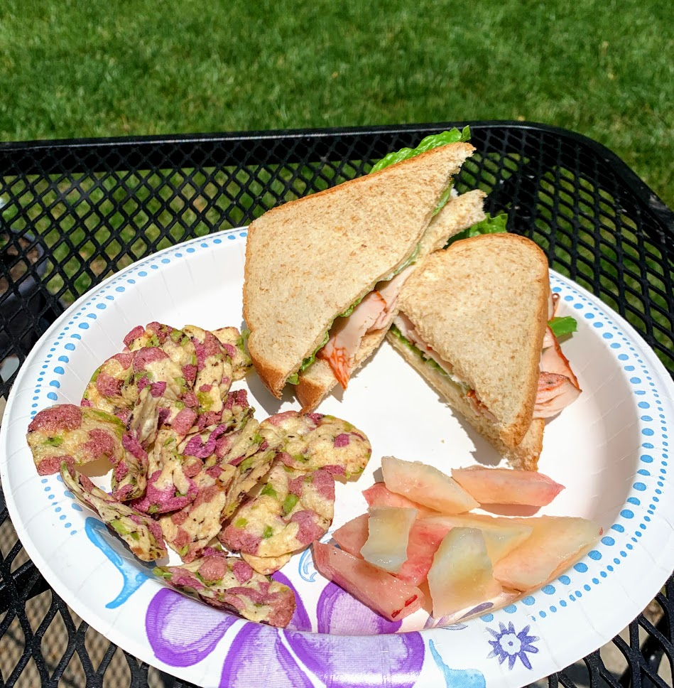 Sandwiches, chips and fruit are the perfect picnic food.