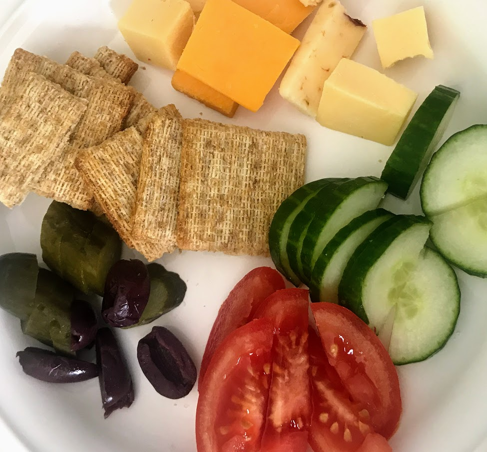 Enjoy a simple lunch of veggies, cheese and crackers while on vacation. Save time and money!