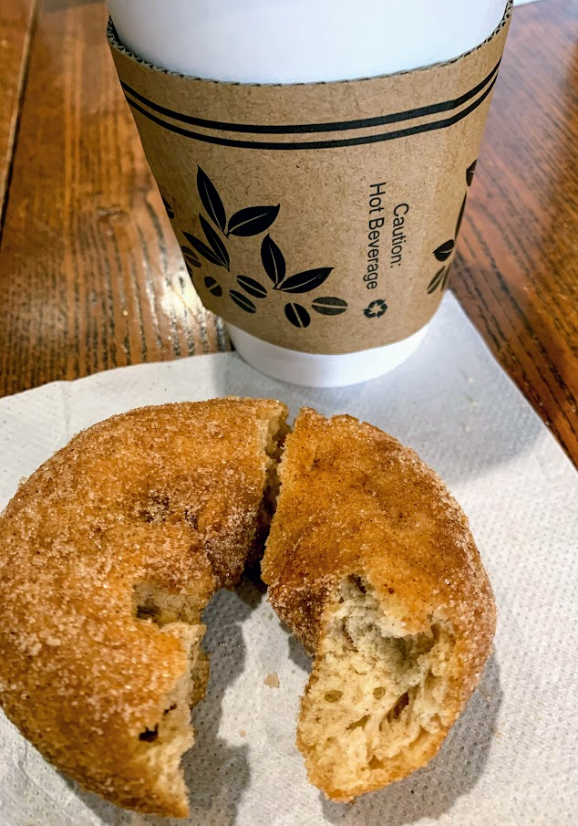 Apple cider donut and fresh coffee at Aroma Coffee Shop in Miami County, Indiana