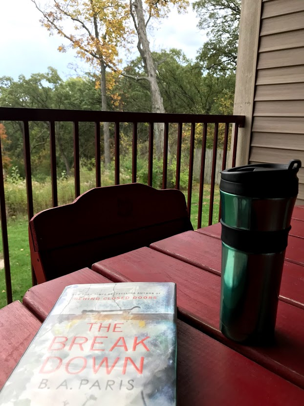 Reading with a good cup of coffee while on vacation.